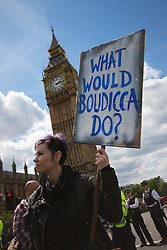 "ter, London, May 30th 2015. Anti-austerity campaigners bring traffic on Westminster Bridge as they paint and hang a banner off the bridge highlighting an alleged £120 billion owed in taxes as compared to the proposed £12 billion cuts to welfare. PICTURED: A woman asks ""What would Boudicca do?"""