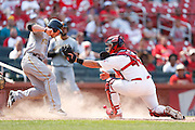 ST. LOUIS, MO - JUNE 30: Alex Presley #7 of the Pittsburgh Pirates slides safely into home plate to score a run ahead of the tag by Tony Cruz #48 of the St. Louis Cardinals at Busch Stadium on June 30, 2012 in St. Louis, Missouri. The Pirates won 7-3 as temperatures reached 103 degrees during the game. (Photo by Joe Robbins)