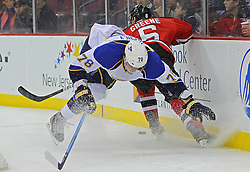 Feb 9; Newark, NJ, USA; New Jersey Devils defenseman Andy Greene (6) hits St. Louis Blues center Evgeny Grachev (78) during the first period at the Prudential Center.