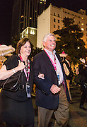 Susan Brennan and Ralph Brennan in second line parade celebrating the opening night of the 25th anniversary New Orleans Film Festival