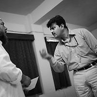 At a hospital run by Imarate Shariya (a Unicef partner focussing on education and health issues in Bihar, Orissa and Jharkhand), Unicef Subregional Coordinator for South West Bihar, with Maulana Anisur Rehman Qasmi, member of the board for Imarate Shariya.  ..Photo: Tom Pietrasik.Patna, Bihar, India..November 7th 2006