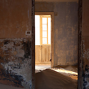 Remains of life on the walls of an old home in Kolmanskop, Namibia
