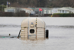 © Licensed to London News Pictures. 22/12/2019. Yalding, UK. Flood water surrounds a horse box in a field next to the Little Venice caravan park near Yalding in Kent after the River Meday burst its banks. River levels remain high after a second night of heavy rain in the south. More rain is expected today. Photo credit: Peter Macdiarmid/LNP