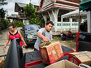 18 SEPTEMBER 2015 - BANGKOK, THAILAND: A man who is being evicted from his home near Wat Kalayanamit moves out of the neighborhood. Fiftyfour homes around Wat Kalayanamit, a historic Buddhist temple on the Chao Phraya River in the Thonburi section of Bangkok are being razed and the residents evicted to make way for new development at the temple. The abbot of the temple said he was evicting the residents, who have lived on the temple grounds for generations, because their homes are unsafe and because he wants to improve the temple grounds. The evictions are a part of a Bangkok trend, especially along the Chao Phraya River and BTS light rail lines. Low income people are being evicted from their long time homes to make way for urban renewal.             PHOTO BY JACK KURTZ