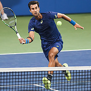 YUKI BHAMBRI hits a volley during his second round match at the Citi Open at the Rock Creek Park Tennis Center in Washington, D.C.