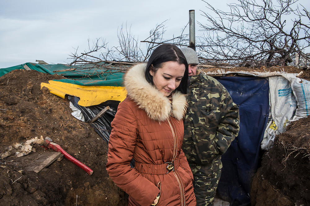 GORLOVKA, UKRAINE - JANUARY 31, 2015: Yulia, a local pro-rebel activist and a rebel fighter stand in a trench at a front-line rebel position in Gorlovka, Ukraine. Fighting in Ukraine has intensified over the last week, with rebels declaring the end of a September ceasefire. CREDIT: Brendan Hoffman for The New York Times