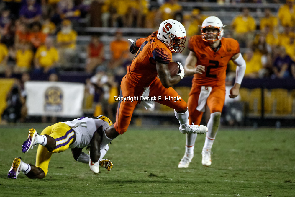 Sep 23, 2017; Baton Rouge, LA, USA; Syracuse Orange running back Dontae Strickland (4) escapes a tackle by LSU Tigers defensive back Donte Jackson (1) during the fourth quarter of a game at Tiger Stadium. LSU defeated Syracuse 35-26. Mandatory Credit: Derick E. Hingle-USA TODAY Sports