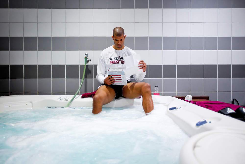 MIAMI, FL -- January 29, 2012 -- Miami forward Shane Battier reads pre-game notes in the hot tub in the Heat's locker room prior to their 97-93 win over the Chicago Bulls at American Airlines Arena in Miami, Fla., on Sunday, January 29, 2012.  (Chip Litherland for ESPN the Magazine)