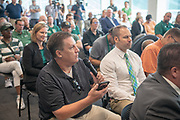 A member of the media asks a question of Ohio University's new Atheletic Director, Julie Cromer, at a press conference at Peden Stadium.