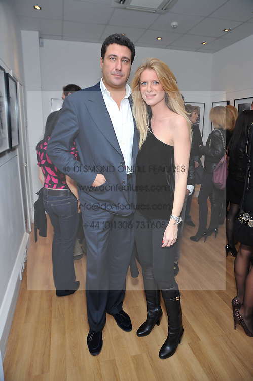 FRANCESCA NARDI and EDUARDO TEODORANI-FABBRI at a private view of photographs by Marina Cicogna from her book Scritti e Scatti held at the Little Black Gallery, 3A Park Walk London SW10 on 16th October 2009.