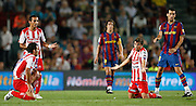 Sporting de Gijon's David Barral, Diego Castro and Alberto Rivera and FC Barcelona's Carles Puyol and Sergio Busquets during  La Liga match.August 31 2009.