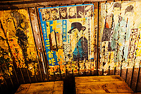 Old posters and advertisements at a bar in downtown Tokyo, Japan.
