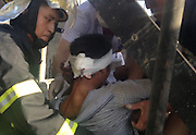 FUZHOU, CHINA - FINLAND OUT<br /> <br /> Man Survives After Steel Bar Pierces The Back Of His Head<br /> <br /> Firefighters raise a worker up after cutting the steel bar on September 24, 2013 in Fuzhou, Fujian Province of China. The man survived after a scaffold he was standing on collapsed at a construction site on Tuesday. He landed right on top of a 2cm in-diameter steel bar that pierced the back of his head. <br /> ©Exclusivepix