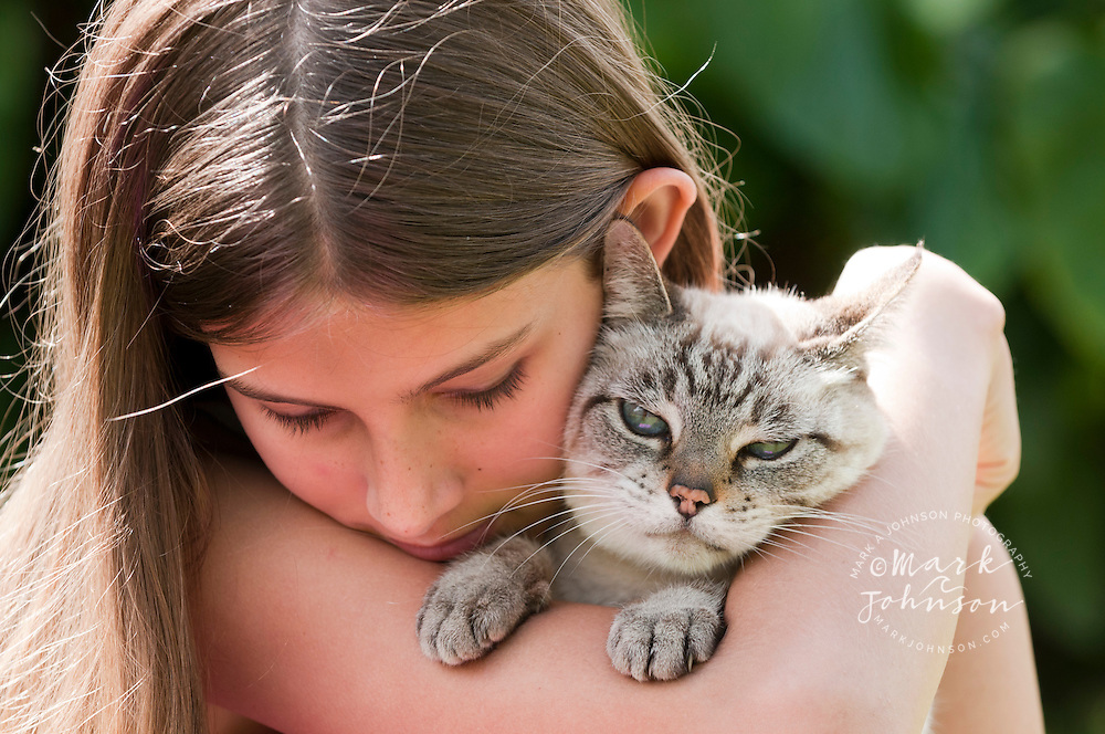 13 year old girl with her pet cat, Kauai, Hawaii people *****Property Release available ****Model Release available