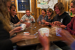 Students gather in the mess hall at Kluane Lake Research Station for a game of spoons and socializing.