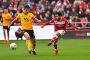 Jay Dasilva (3) of Bristol City passes the ball as Leander Dendoncker (32) of Wolverhampton Wanderers closes in on him during the The FA Cup 5th round match between Bristol City and Wolverhampton Wanderers at Ashton Gate, Bristol, England on 17 February 2019.