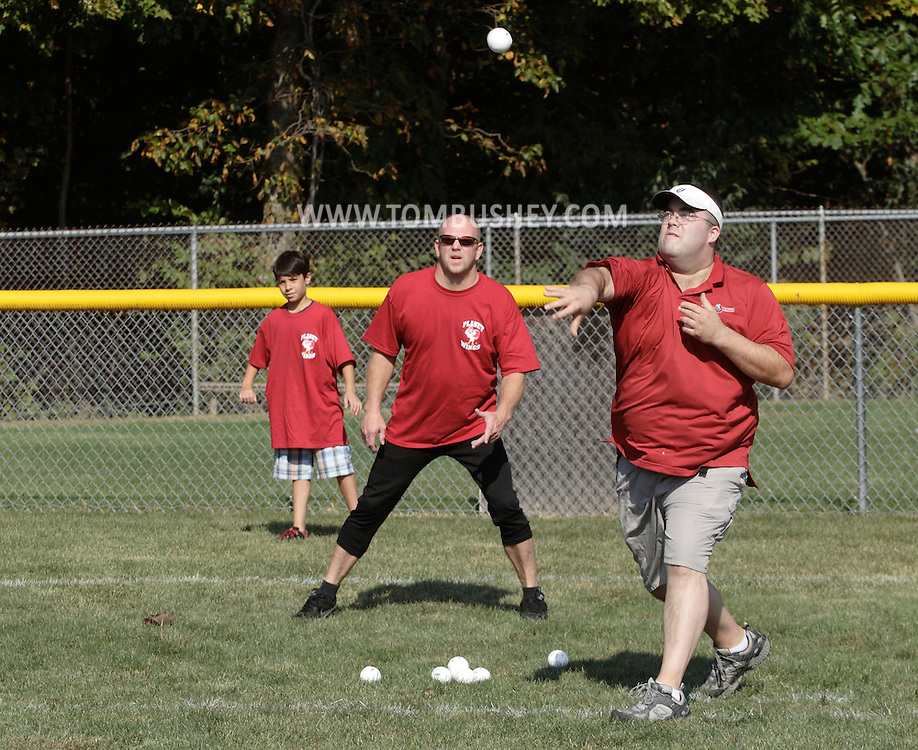 Scotchtown, New York - A pitcher throws the ball during the Wiffle for Kids charity Wiffle Ball tournament at the Town of Wallkill Little League fields on Sept. 25, 2010.