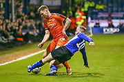 Sheffield Wednesday midfielder Barry Bannan (10) tackles Luton Town forward James Collins (19) during the The FA Cup 3rd round replay match between Luton Town and Sheffield Wednesday at Kenilworth Road, Luton, England on 15 January 2019.