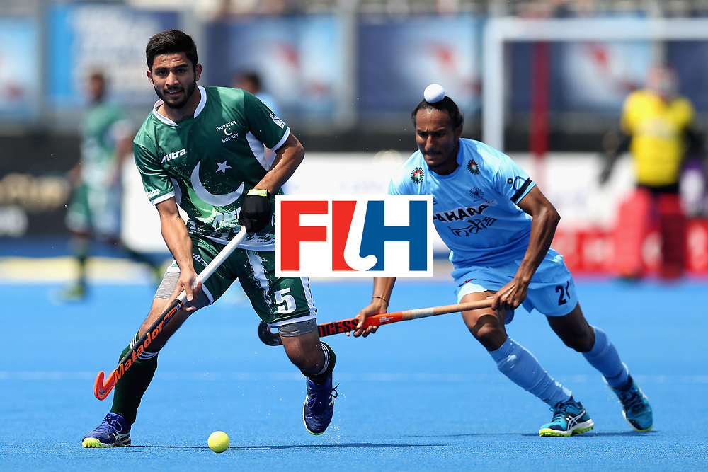 LONDON, ENGLAND - JUNE 18: Abu Mahmood of Pakistan runs past Akashdeep Singh of India during the Hero Hockey World League Semi Final match between Pakistan and India at Lee Valley Hockey and Tennis Centre on June 18, 2017 in London, England.  (Photo by Alex Morton/Getty Images)