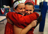 10 DEC. 2010 -- ST. LOUIS -- Assumption School volleyball player Bridget Ringwald (left) is congratulated by her sister Mary Ringwald, a freshman at Cor Jesu Academy, after Assumption beat Holy Infant School during the championship match of the CYC girls' parochial closed division tournament at the Monsignor Meyer Youth Center in St. Louis Friday Dec. 10, 2010. Image © copyright 2010 Sid Hastings.