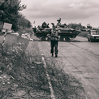 14 May 2014 - Ukraine - Slaviansk - Ukrainian army checkpoint in between Donetsk and Slavianks. This soldier saw me taking photos and come to warn me to immediately stop otherwise, he will cease my equipment.