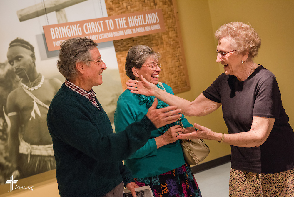 Former missionaries David and Mona Houser greet fellow former missionary Eunice Hausler (right) during the public opening of Concordia Historical Institute's museum exhibit 'Bringing Christ to the Highlands' in Papua New Guinea on Sunday, Oct. 5, 2014, on the campus of Concordia Seminary in Clayton, Mo. LCMS Communications/Erik M. Lunsford