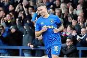 AFC Wimbledon striker Cody McDonald (10) celebrating after scoring goal to make it 2-2 during the EFL Sky Bet League 1 match between AFC Wimbledon and Peterborough United at the Cherry Red Records Stadium, Kingston, England on 12 November 2017. Photo by Matthew Redman.