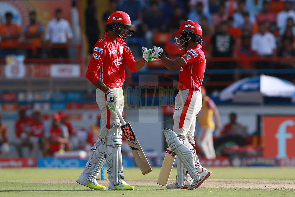 Axar Patel of KXIP and Wriddhiman Saha of KXIP during match 26 of the Vivo 2017 Indian Premier League between the Gujarat Lions and the Kings XI Punjab held at the Saurashtra Cricket Association Stadium in Rajkot, India on the 23rd April 2017<br /> <br /> Photo by Rahul Gulati - Sportzpics - IPL