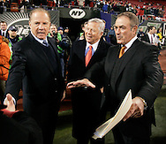 Former ABC Monday Night Football announcer Frank Gifford, Patriots owner Bob Kraft and Al Michales on the field before the last Monday Night Football game on ABC between the New York Jets and the New England Patriots at Giants Stadium, in East Rutherford NJ Monday 26 December 2005