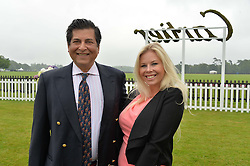 ASHWAN KHANNA and JENNA WALL at the Cartier Queen's Cup Polo final at Guard's Polo Club, Smiths Lawn, Windsor Great Park, Egham, Surrey on 14th June 2015