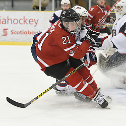 WELLINGTON, - Dec 11, 2015 -  Exhibition Game 2- Team USA vs Team Canada East at the 2015 World Junior A Challenge at the Wellington District Community Centre, ON. Josh Kosack #21 of Team Canada East battles for control during the second period.<br /> (Photo: Andy Corneau / OJHL Images)