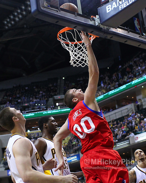 March 14, 2012; Indianapolis, IN, USA; Philadelphia 76ers center Spencer Hawes (0) puts up a shot under the basket against the Indiana Pacers at Bankers Life Fieldhouse. Mandatory credit: Michael Hickey-US PRESSWIRE