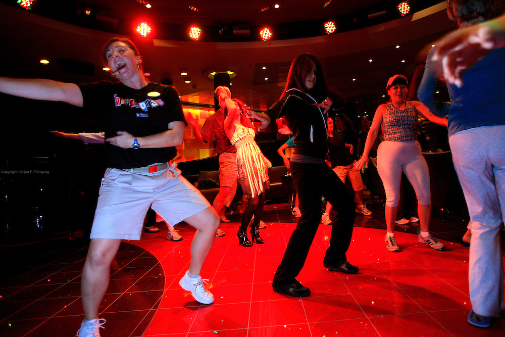 Instructors and passengers dancing salsa onboard the cruise ship Oasis of the Seas. The ship, currently the largest in the world, is owned by Royal Carribean Cruise Line.