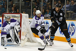 April 4, 2011; San Jose, CA, USA;  San Jose Sharks center Joe Thornton (19) passes the puck around Los Angeles Kings defenseman Drew Doughty (8) and goalie Jonathan Quick (32) during the first period at HP Pavilion. San Jose defeated Los Angeles 6-1. Mandatory Credit: Jason O. Watson / US PRESSWIRE