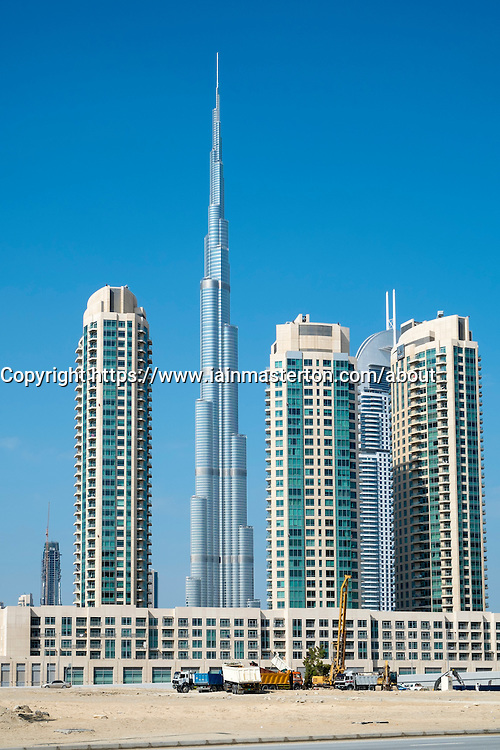 Apartment towers and Burj Khalifa at new Business Bay commercial and residential area in Dubai United Arab Emirates