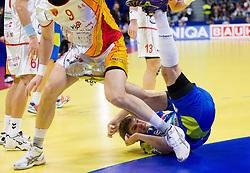 Ace Jonovski of FYR Macedonia and Sebastian Skube of Slovenia during handball match between Slovenia and F.Y.R. Macedonia for 5th place at 10th EHF European Handball Championship Serbia 2012, on January 27, 2012 in Beogradska Arena, Belgrade, Serbia.  (Photo By Vid Ponikvar / Sportida.com)