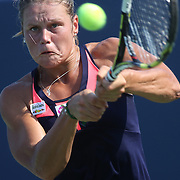 Karin Knapp, Italy, in action against Caroline Wozniacki, Denmark, during the New Haven Tennis Open at Yale,, Connecticut, USA. 20th August 2013. Photo Tim Clayton