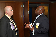 Mark Graham of the BBB (left) and Donerik Black of Unified Health Solutions during the Better Business Bureau's Eclipse Integrity Awards dinner at Sinclair Community College's Ponitz Center in downtown Dayton, Tuesday, May 14 2013.