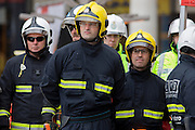 Firefighters from the London Fire Brigade's 'extrication' team with the Vehicle and Operator Services Agency (VOSA) gives a demonstration on how firefighters rescue passengers by cutting open with dedicated cutting equipment a stretch limousine in London's Covent Garden Piazza. Highlighting the dangers of hiring illegal luxury or novelty cars, this vehicle was seized last year with many mechanical defects rendering it unsafe for those inside with limited exit doors. Of 358 cars stopped in March 2012, 27 were seized and 232 given prohibitions. This scenario is a simulation and therefore reproduces the reality of an emergency, using real emergency services personnel and equipment. Casualties are volunteers and none were injured in the making of this photograph.