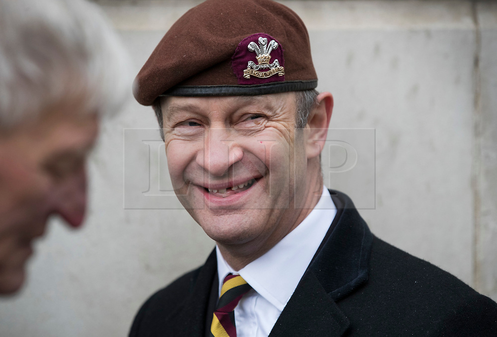 © Licensed to London News Pictures. 03/02/2018. London, UK. UKIP Leader Henry Bolton wearing the beret of The Royal Hussars, his former British Army regiment, shares a joke as he takes part in a Veterans for Justice March in central London .Photo credit: Peter Macdiarmid/LNP