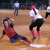 Lauren Wood   Buy at photos.djournal.com<br /> Nettleton's Jolie Parker slides into third base as Mooreville's Summer Cryder waits for the ball during Tuesday night's 3A softball semifinal game. Nettleton defeated Moorville 28-13.