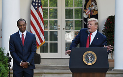 U.S. President Donald Trump speaks as golf legend Tiger Woods looks on during the Presidential Medal of Freedom ceremony in the Rose Garden at the White House, May 6, 2019 in Washington, DC. Photo by Olivier Douliery/ABACAPRESS.COM