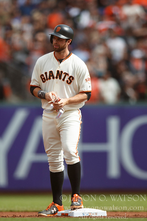SAN FRANCISCO, CA - OCTOBER 02: Brandon Belt #9 of the San Francisco Giants stands on second base after hitting a double against the Los Angeles Dodgers during the first inning at AT&T Park on October 2, 2016 in San Francisco, California. The San Francisco Giants defeated the Los Angeles Dodgers 7-1. (Photo by Jason O. Watson/Getty Images) *** Local Caption *** Brandon Belt