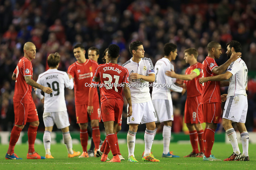 22nd October 2014 - UEFA Champions League - Group B - Liverpool v Real Madrid - Players from both sides, including James Rodriguez of Real and Raheem Sterling of Liverpool, shake hands after the match - Photo: Simon Stacpoole / Offside.