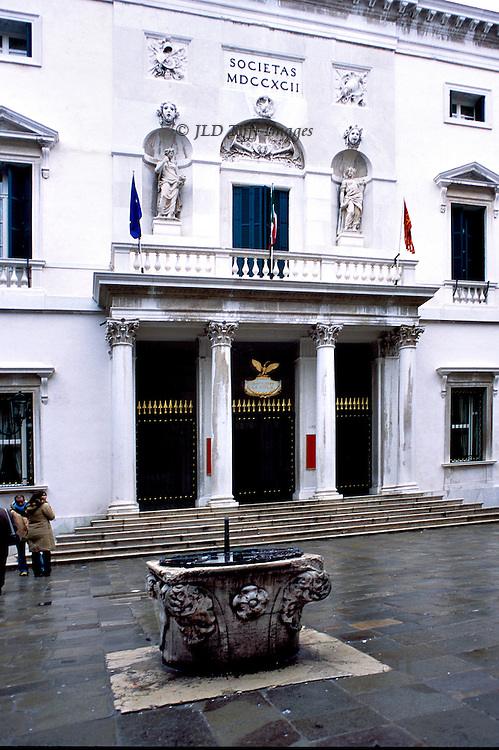 Teatro La Fenice, Venice; restored facade and campo with ancient wellhead in front..Image made in January 2004, shortly after the reopening of the theatre.