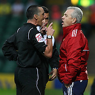 Referee N Swarbrick reads the riot act to Real Zaragoza Manager Javier Aguirre during a pre season friendly at Carrow Road stadium, Norwich...Picture by Paul Chesterton/Focus Images Ltd.  07904 640267.3/8/11