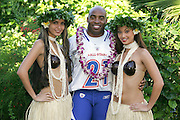 KO OLINA - FEBRUARY 11:  NFC New York Giants 2005 NFL Pro Bowl All-Stars Tiki Barber #21 poses with Hawaiian Hula girls for his 2005 NFL Pro Bowl team photo on February 11, 2005 in Ko Olina, Hawaii. ©Paul Anthony Spinelli
