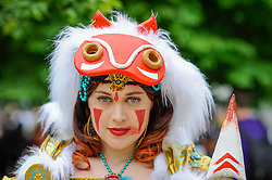 © Licensed to London News Pictures. 28/05/2017. London, UK. A girl dressed as Princess Mononoke at MCM Comic Con taking place at Excel in East London.  The three day event celebrates popular comic books, anime, games, television and movies.  Many attendees take the opportunity to dress as their favourite characters.    Photo credit : Stephen Chung/LNP
