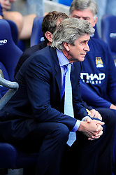 Manchester City Manager, Manuel Pellegrini - Photo mandatory by-line: Dougie Allward/JMP - Tel: Mobile: 07966 386802 22/09/2013 - SPORT - FOOTBALL - City of Manchester Stadium - Manchester - Manchester City V Manchester United - Barclays Premier League