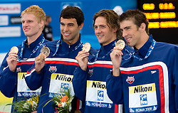 Winning team of USA (David Walters, Ricky Berens,  Ryan Lochte,  Michael Phelps) at the victory ceremony after they competed in the  Men's 4x 200m Freestyle Final  during the 13th FINA World Championships Roma 2009, on July 31, 2009, at the Stadio del Nuoto,  in Foro Italico, Rome, Italy. (Photo by Vid Ponikvar / Sportida)